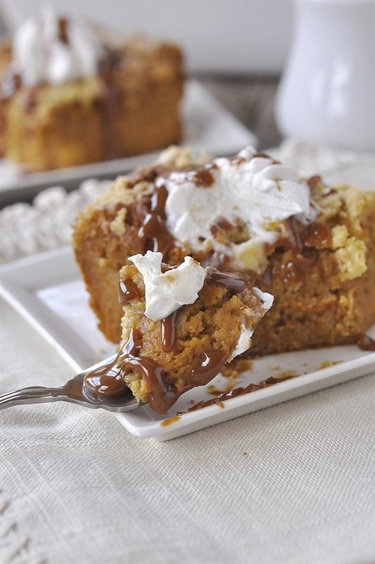Pumpkin Pie Cake with caramel sauce and whipped cream