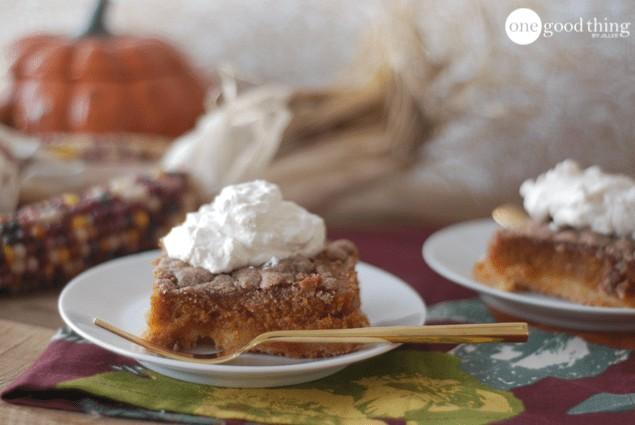 slice of gluten free pumpkin cake with whipped cream