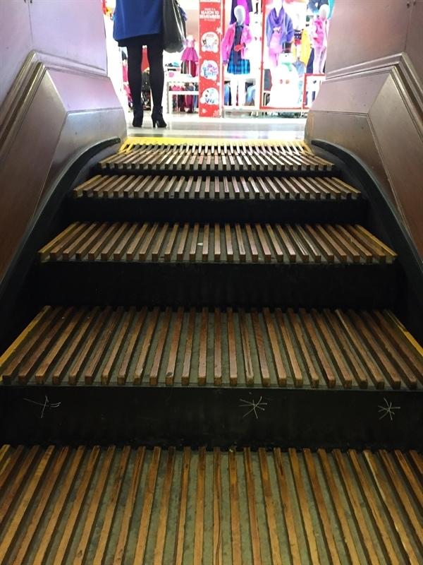 Macy's wooden escalator