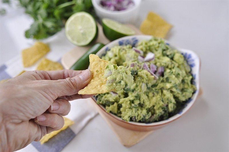 eating guacamole on a chip