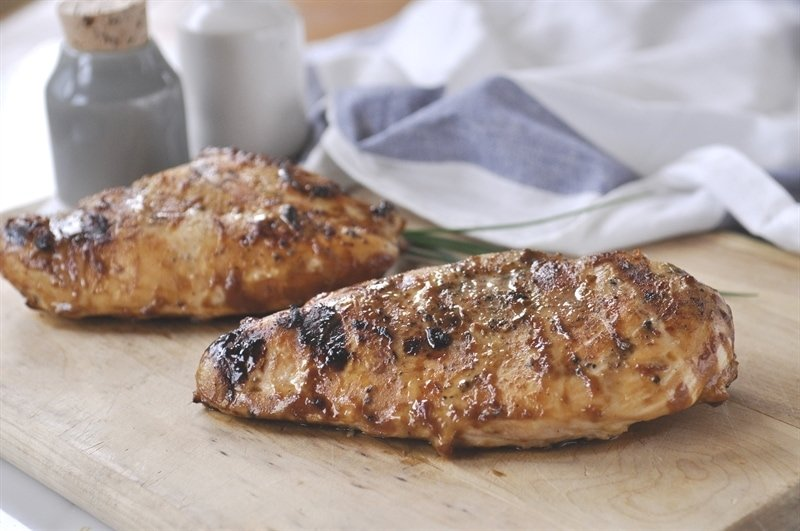 grilled honey mustard chicken breasts on a cutting board