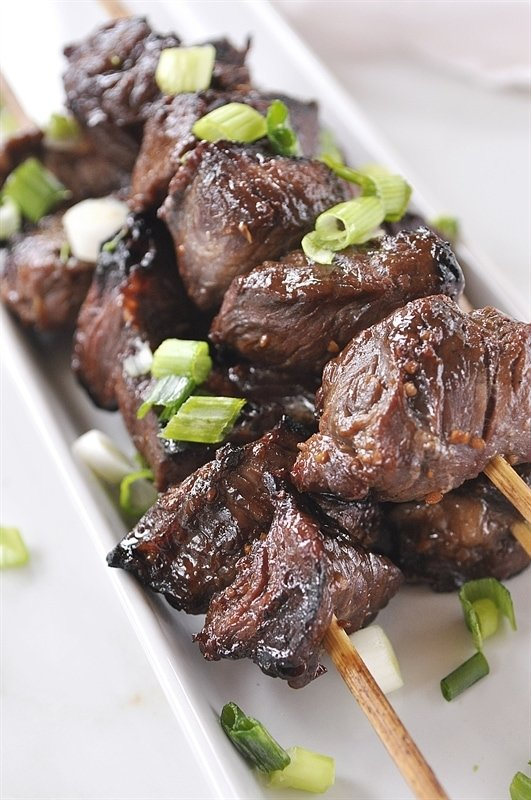 Teriyaki Beef Skewers on a white plate