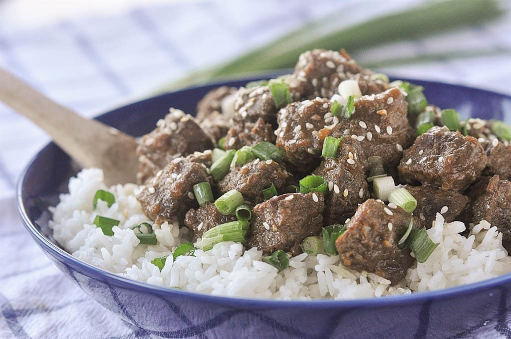 slow cooker teriyaki beef with scallions and sesame seeds