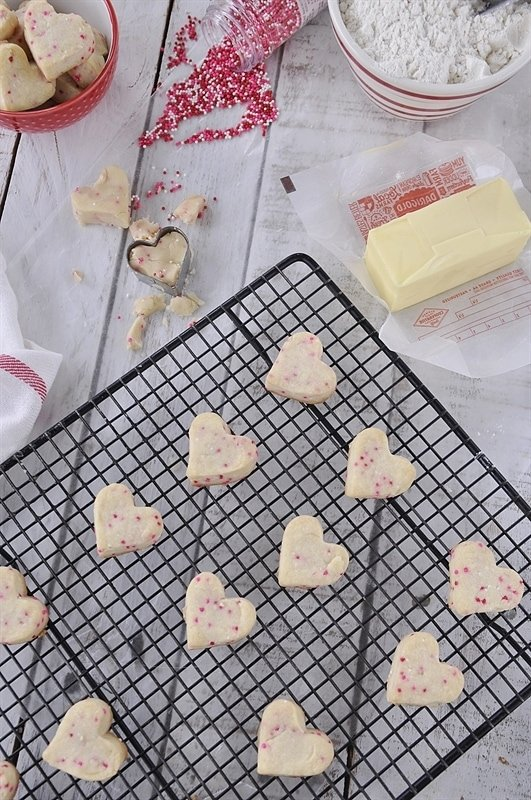 heart shaped shortbread cookies on a cooling rack