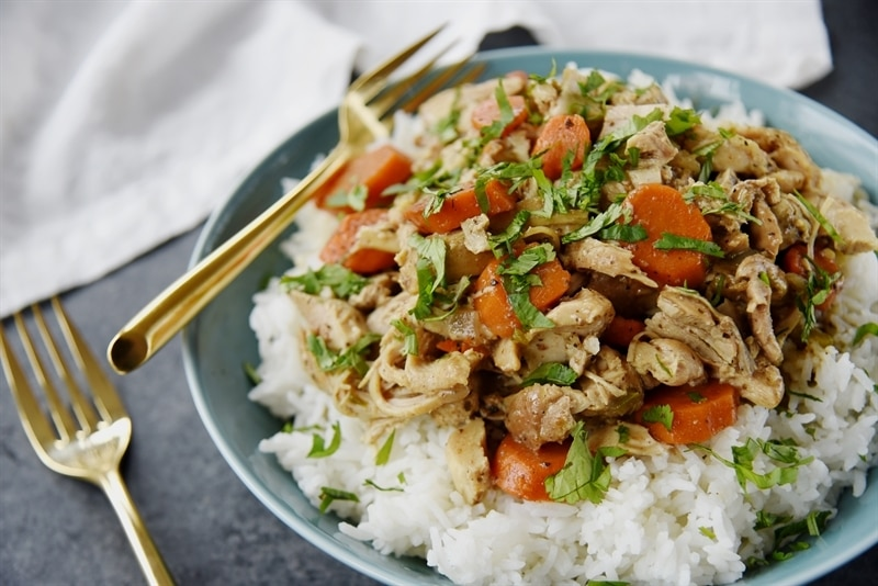 Slow Cooker Chicken Curry and rice in a blue bowl