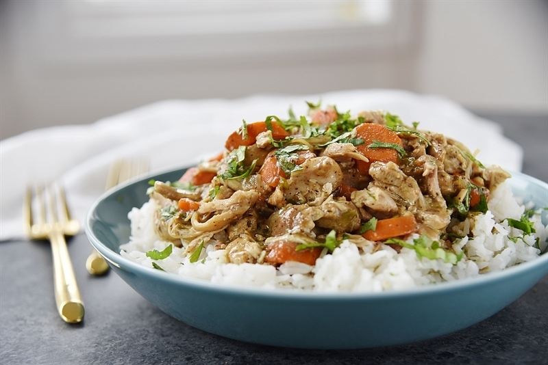 bowl of rice topped with slow cooker chicken curry
