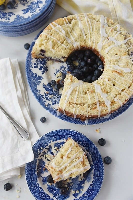 serving a slice of Lemon Blueberry Coffee Cake