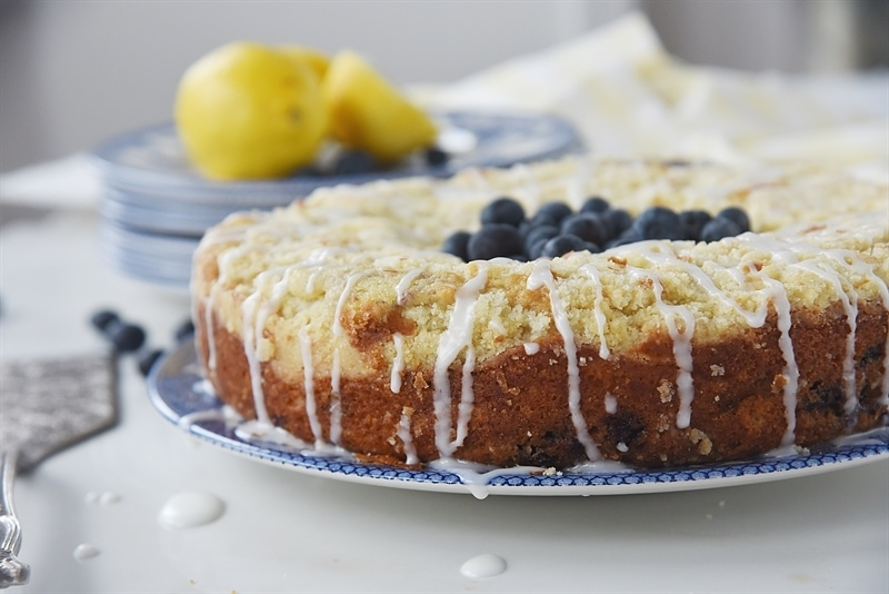 Lemon Blueberry Coffee Cake topped with fresh blueberries and lemon glaze