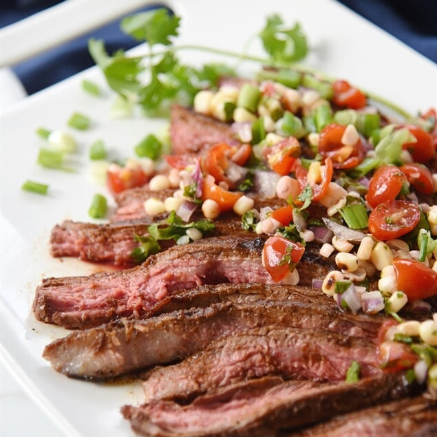 sliced flank steak with grilled corn salsa