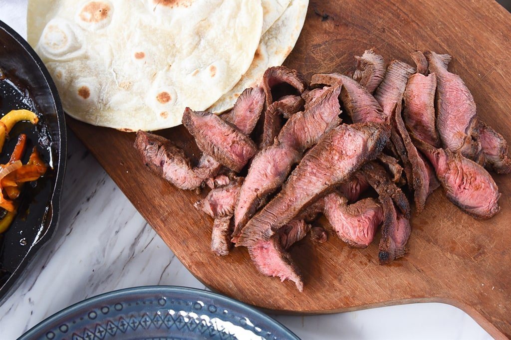 sliced steak for Flat Iron Steak Fajitas