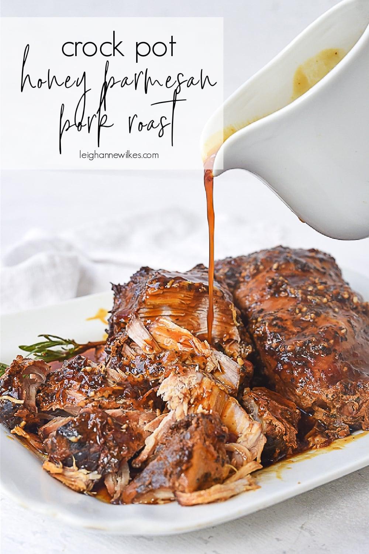 pouring gravy over pork roast