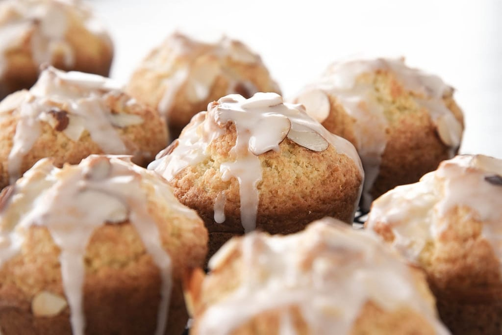 muffins with lemon glaze and sliced almonds