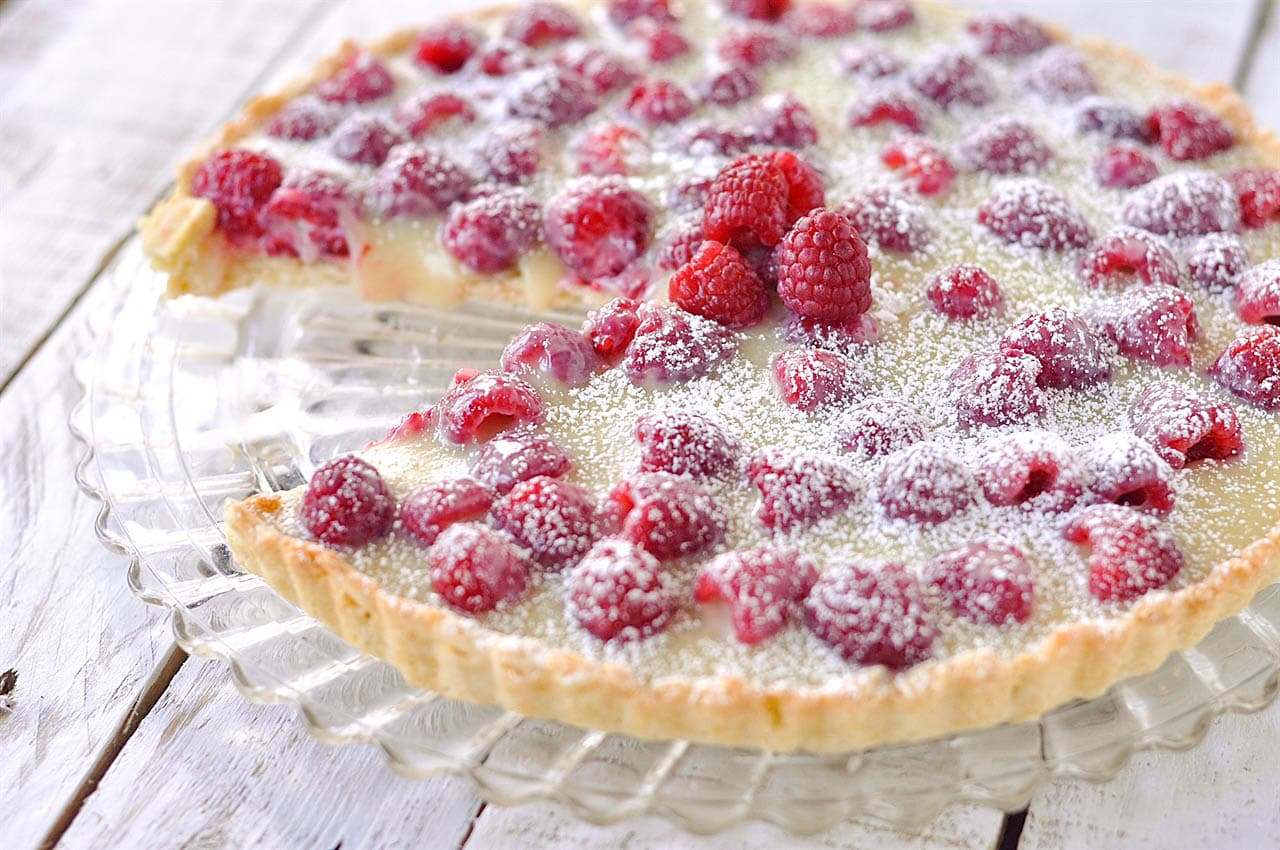 raspberry tart with piece missing