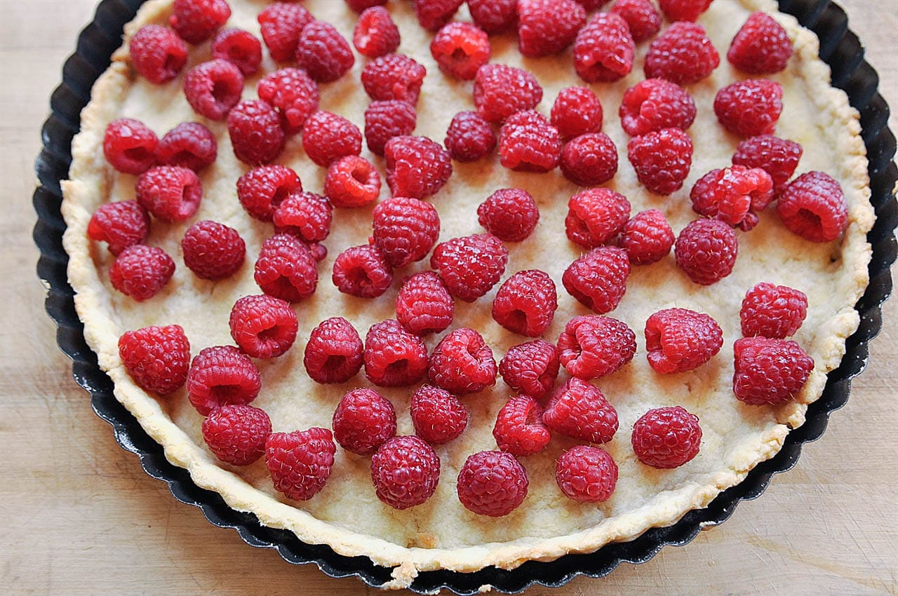 tart filled with raspberries