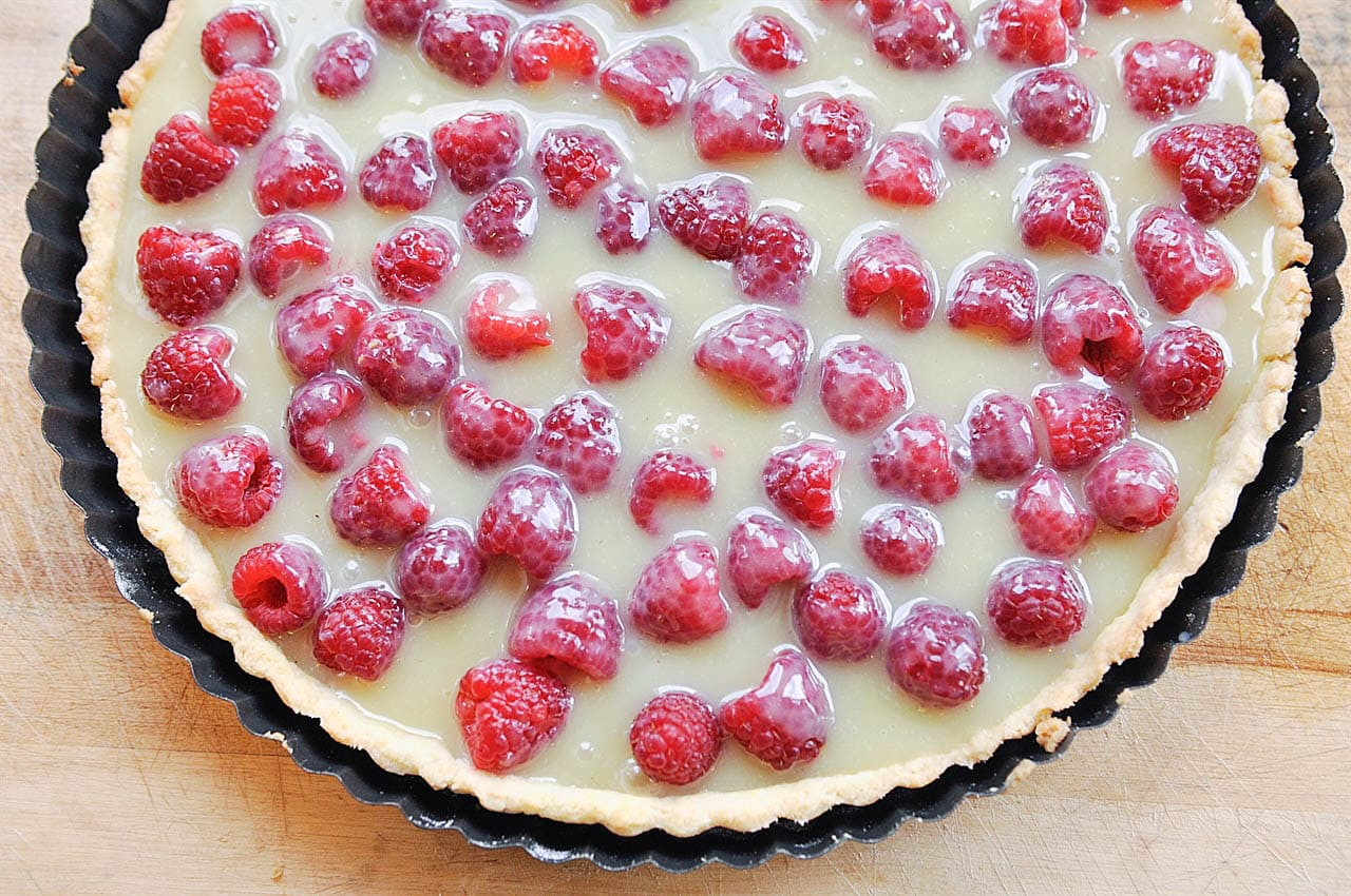 white chocolate over raspberries