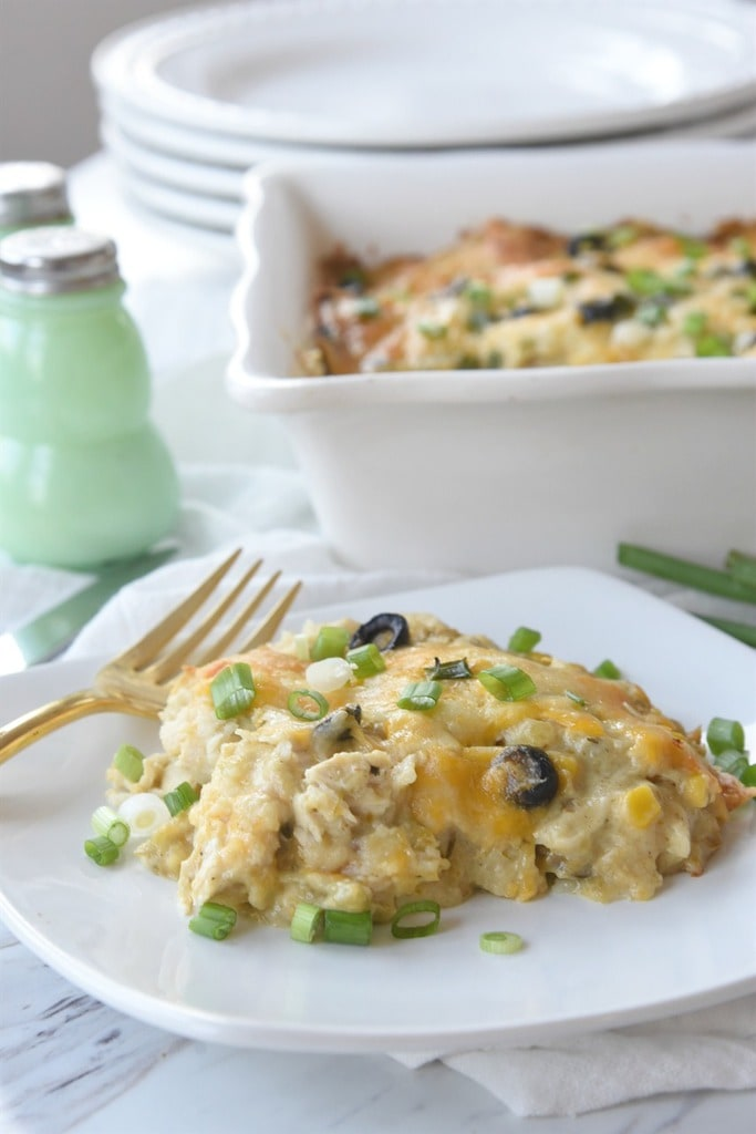 Green Chili enchilada Casserole topped with sliced green onions