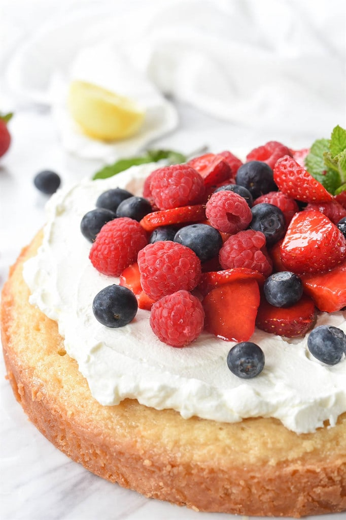 fresh berries and whipped cream topped pound cake