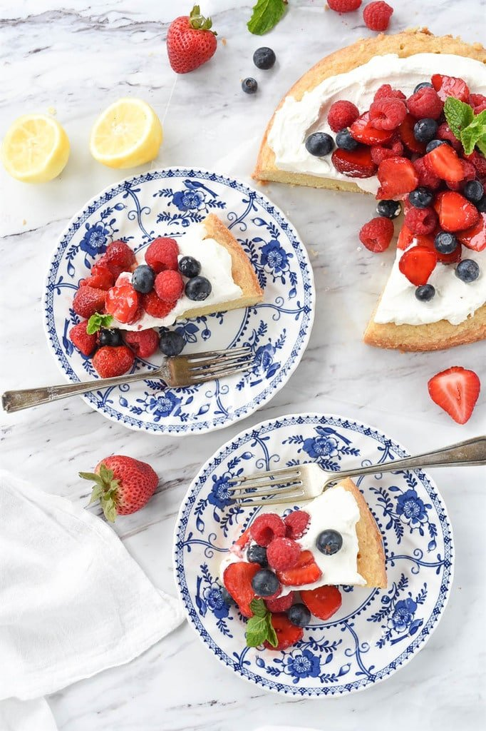 two slices of lemon pound cake with whipped cream and fresh berries