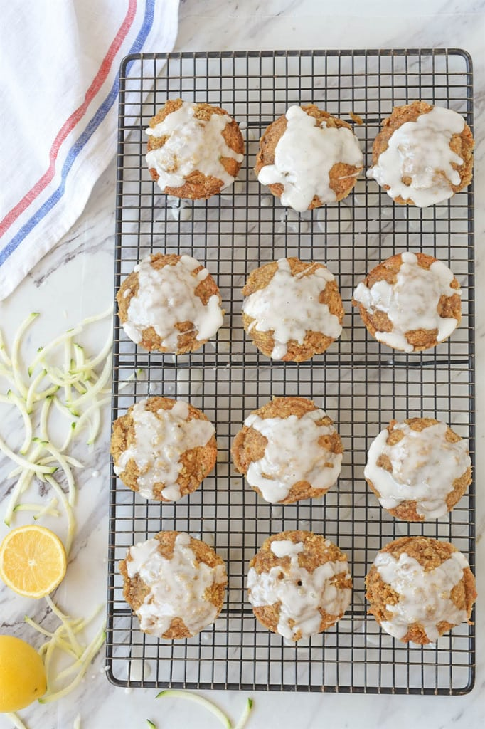 Zucchini Muffins with Streusel Topping and Lemon Glaze on cooling rack