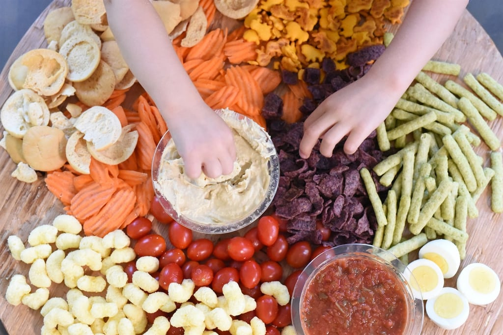 kids hands grabbing healthy snack food