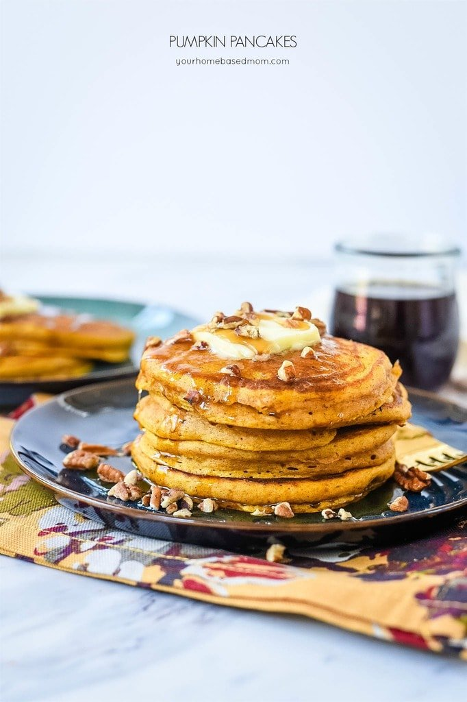 Pumpkin Pancakes with syrup and pecans