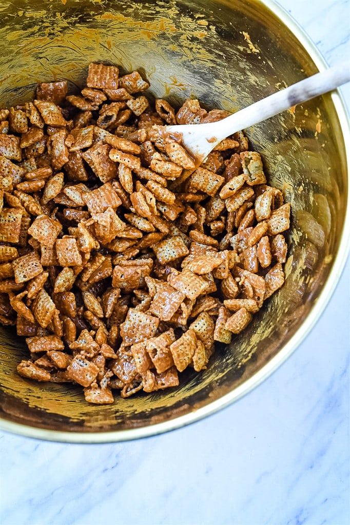 Chex Mix covered in cookie butter for puppy chow