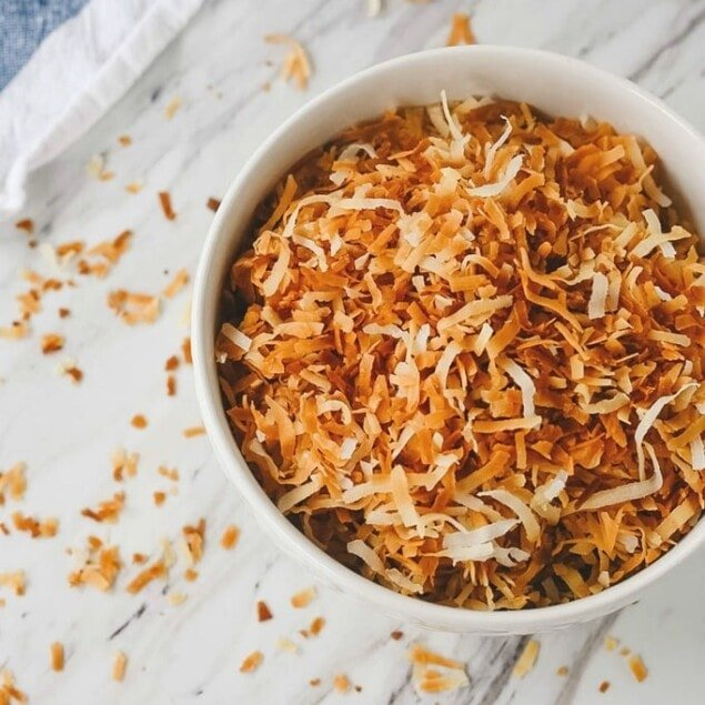 A bowl full of toasted coconut