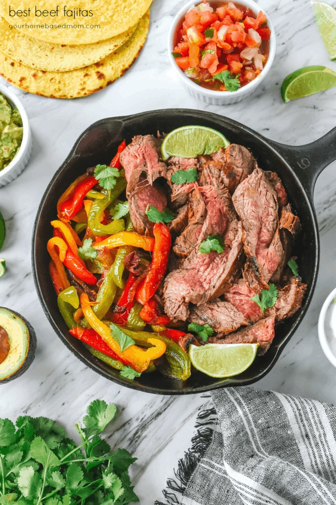 beef fajitas in a cast iron skillet