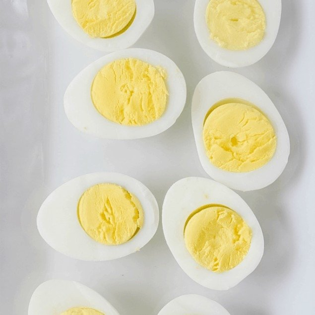 sliced open hard boiled eggs