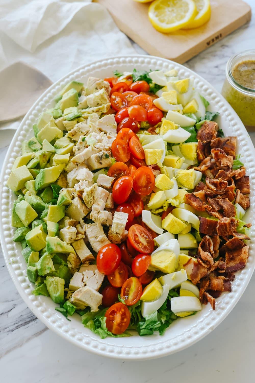 large cobb salad on a white platter