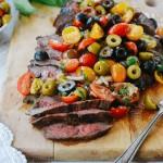 Sliced flank steak with olive relish