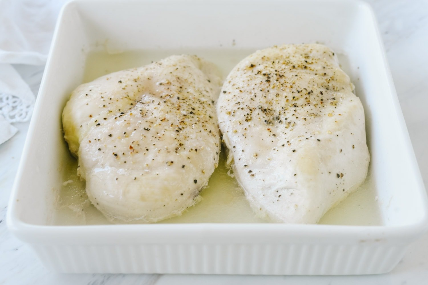 Two chicken breasts in a dish