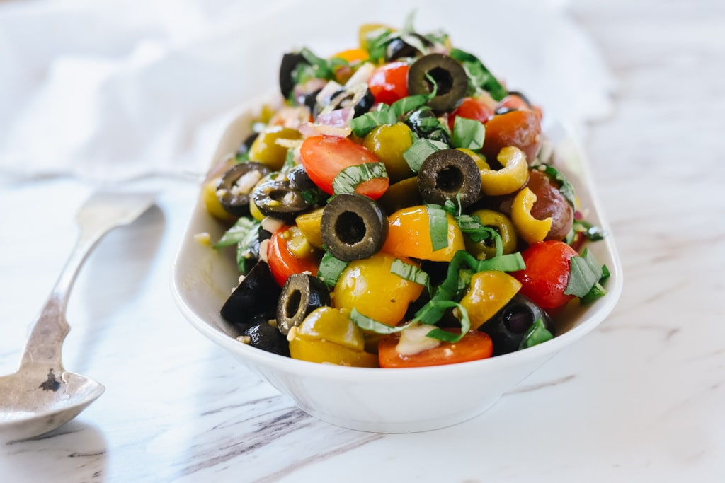 Tomato Olive Relish in bowl with spoon