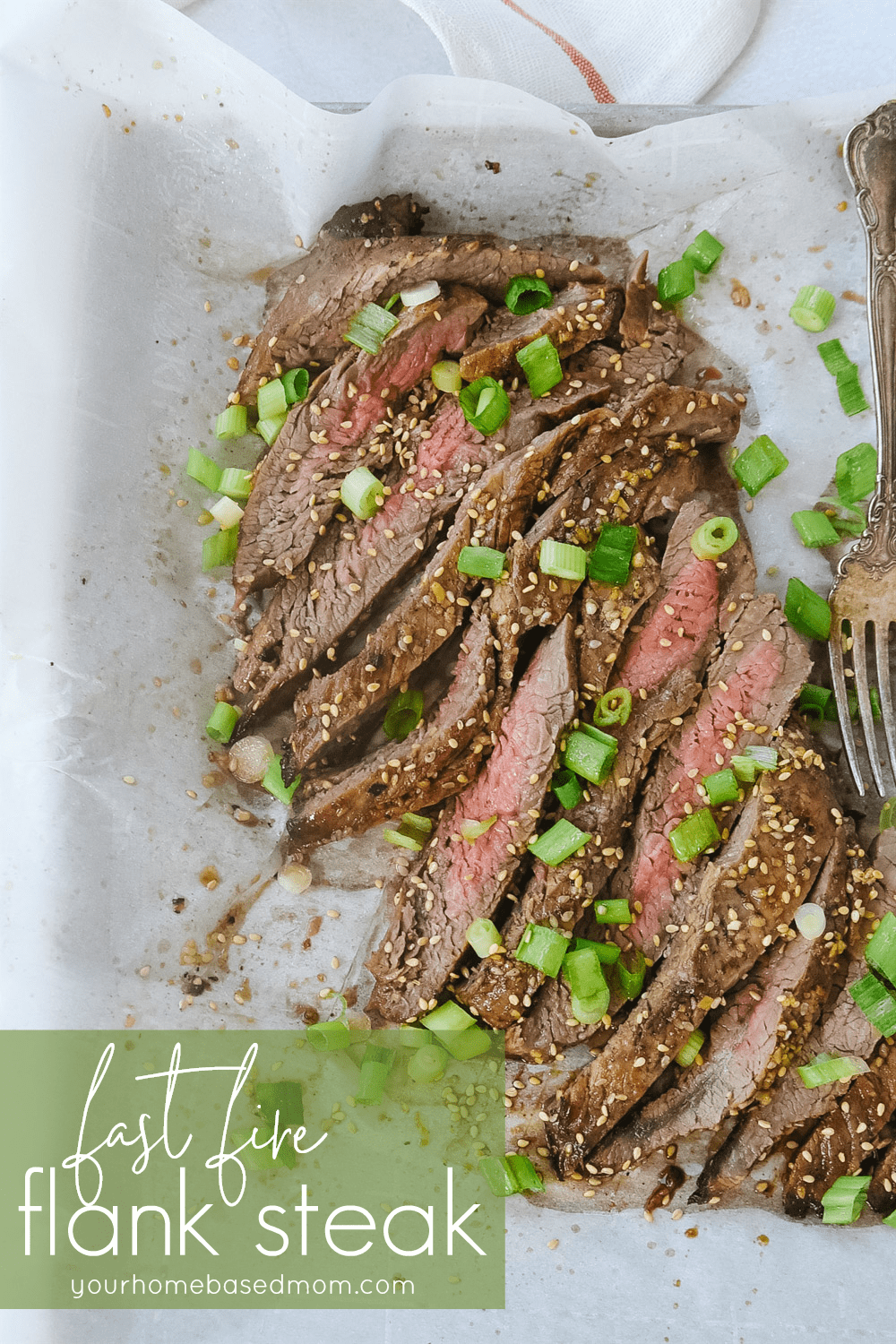 flank steak with green onion on it