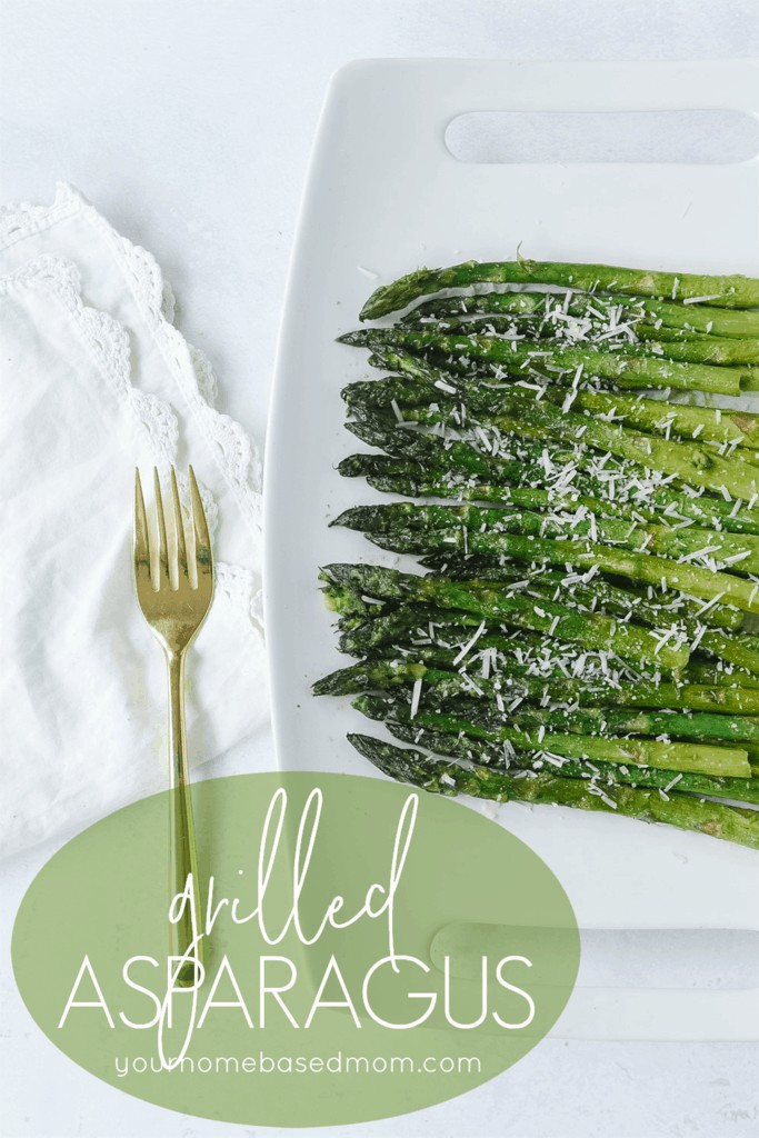 grilled asparagus on a plate with a fork