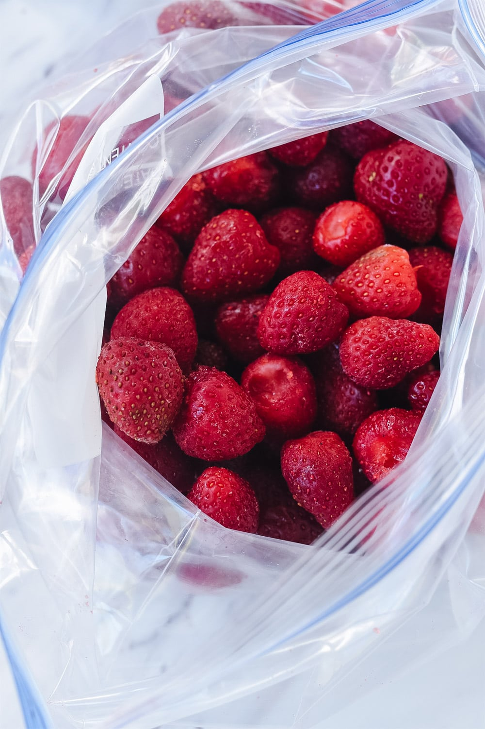 Frozen strawberries in a bag