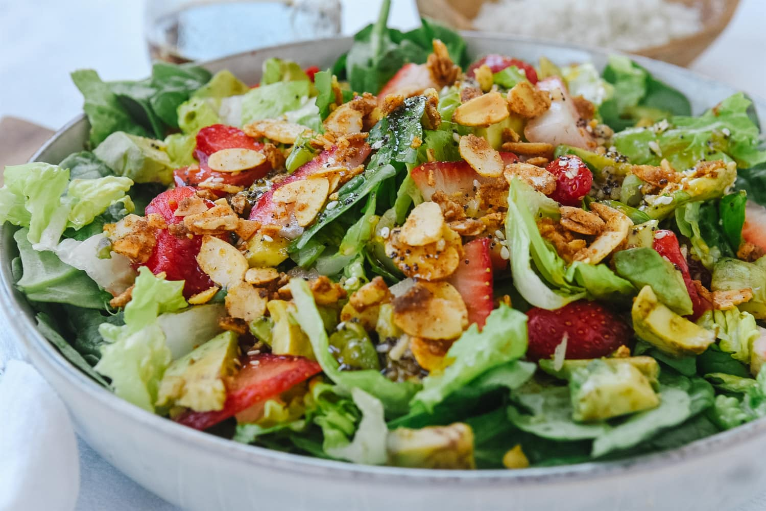 strawberry avocado salad with spiced nuts