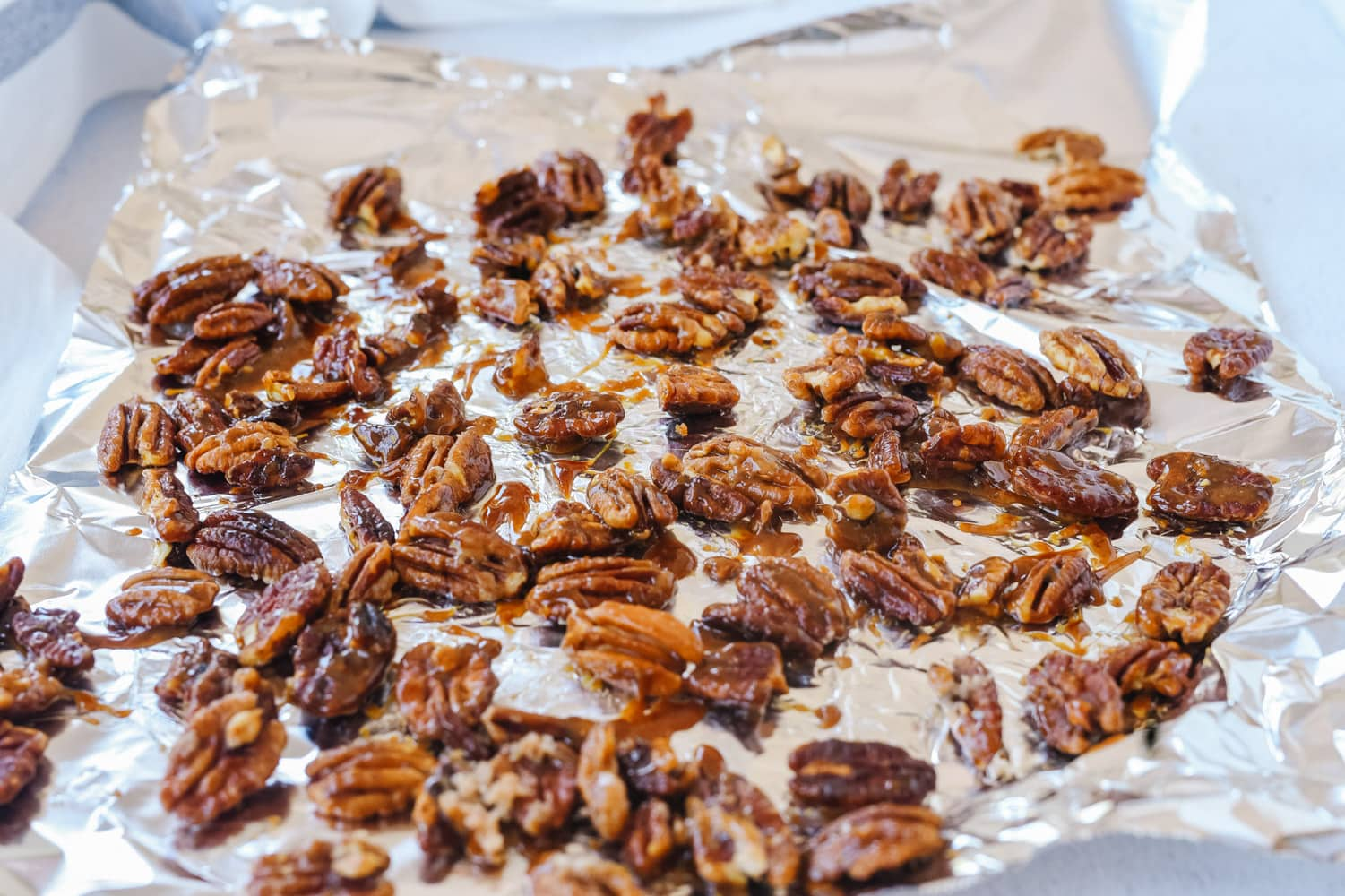 candied pecans on foil