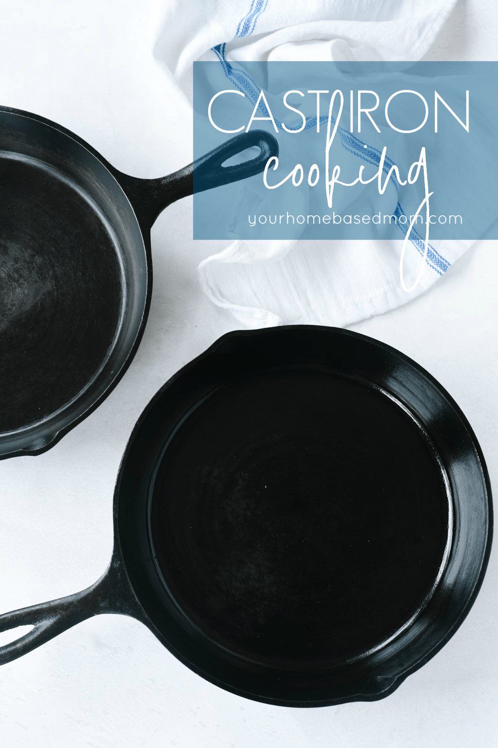 two cast iron pans and a towel