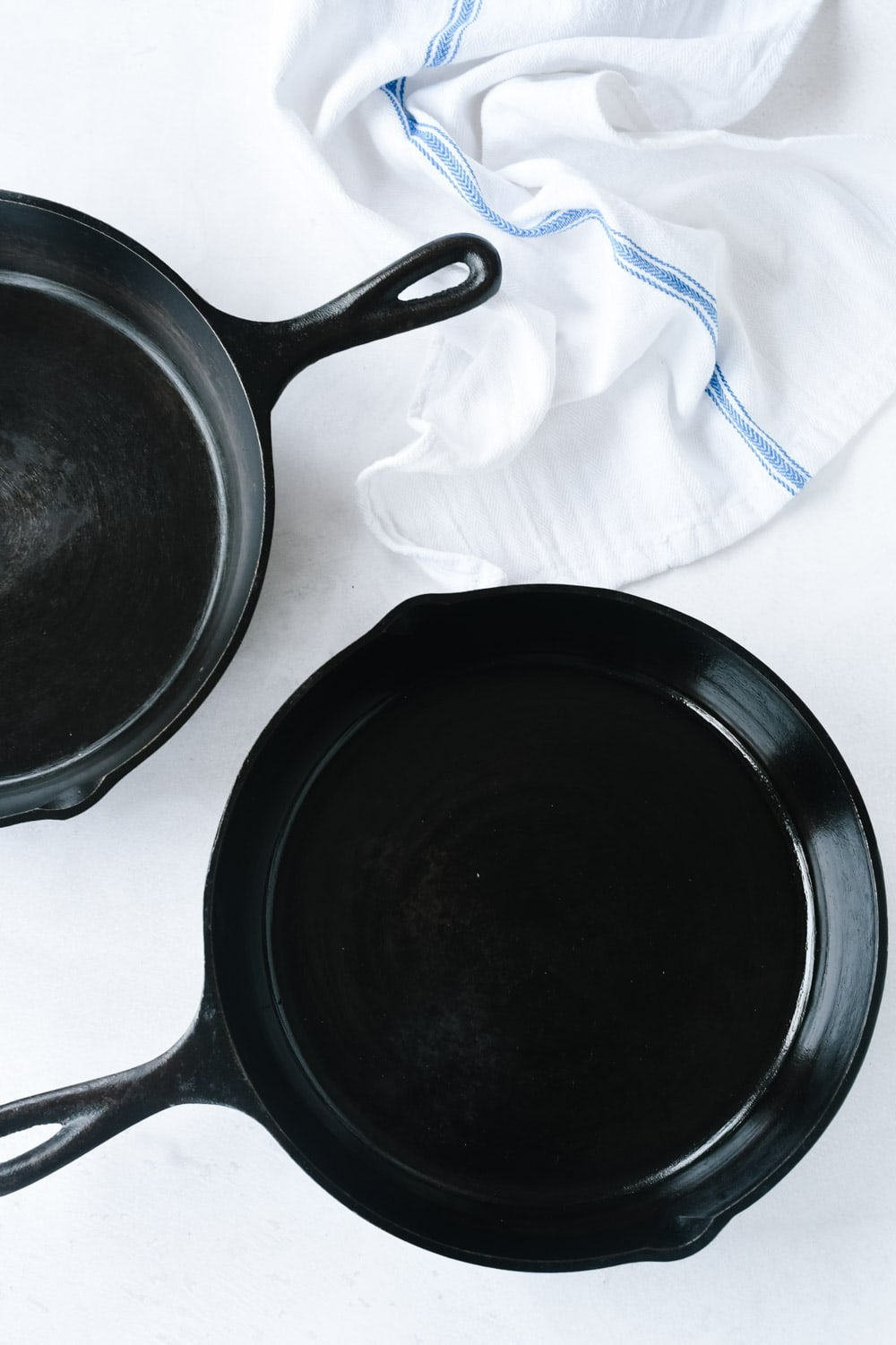 Two cast iron skillets