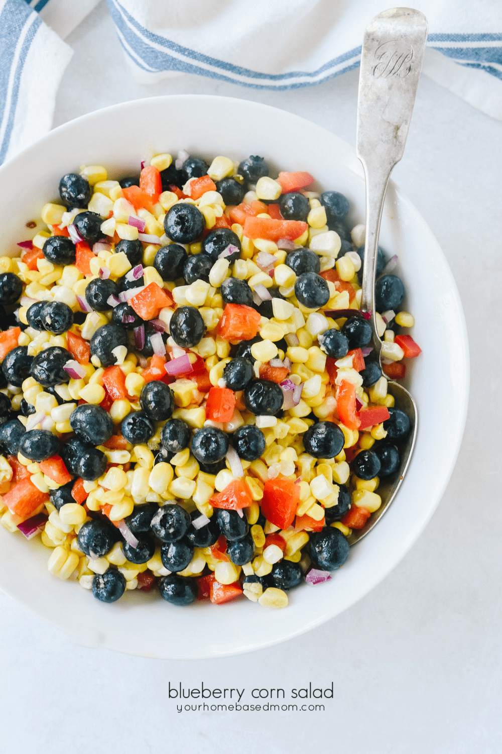blueberry corn salad in a white bowl