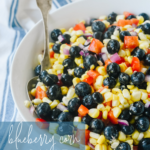 white bowl of blueberry corn salad