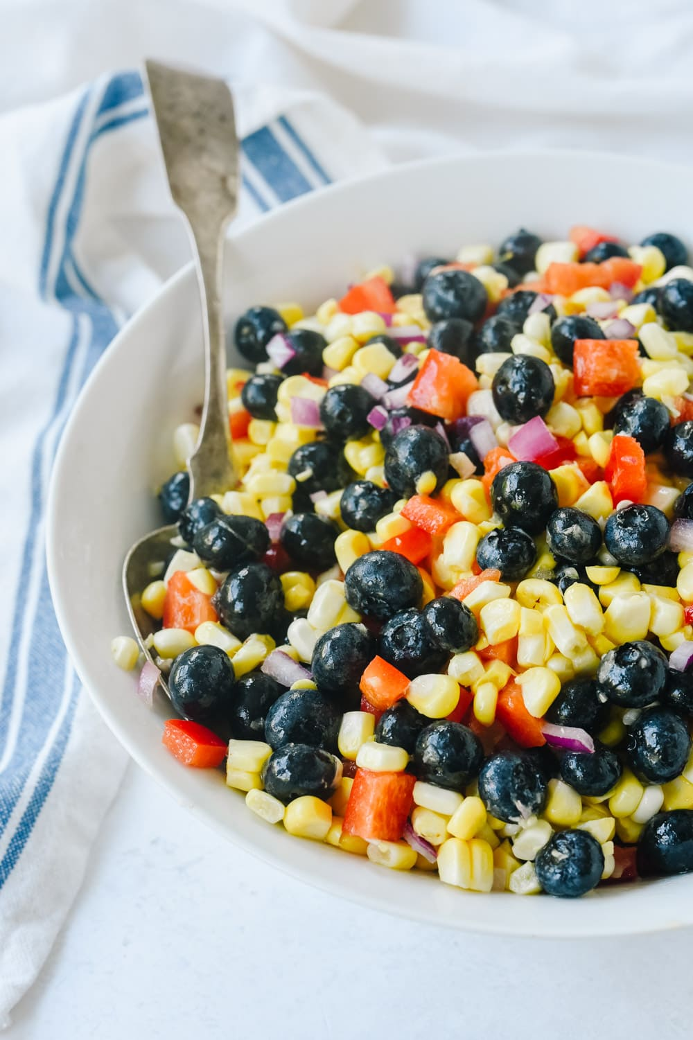 Blueberry Corn Salad with a spoon in it
