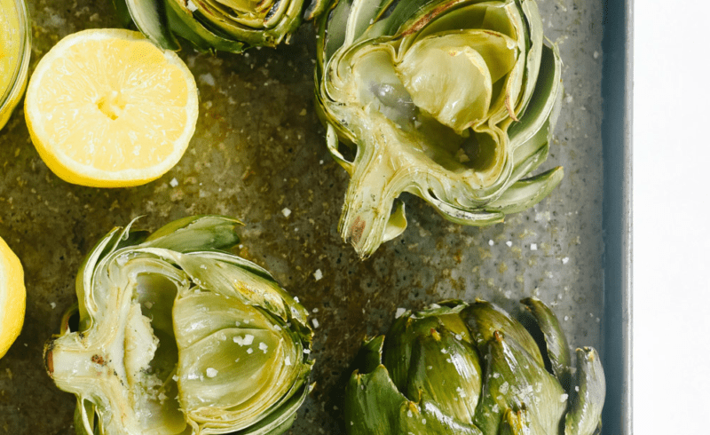 grilled artichokes on a tray