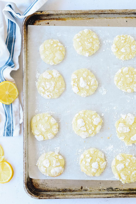 Lemon crinkles on a baking sheet