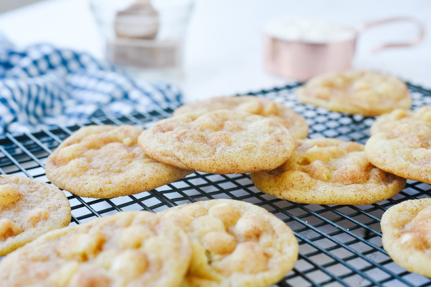White chocolate chip snickerdoodles on a rack