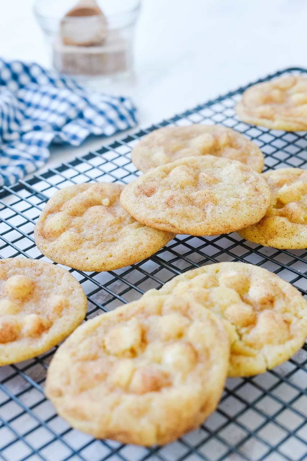 white chocolate snickerdoodle cookies on a cooling rack