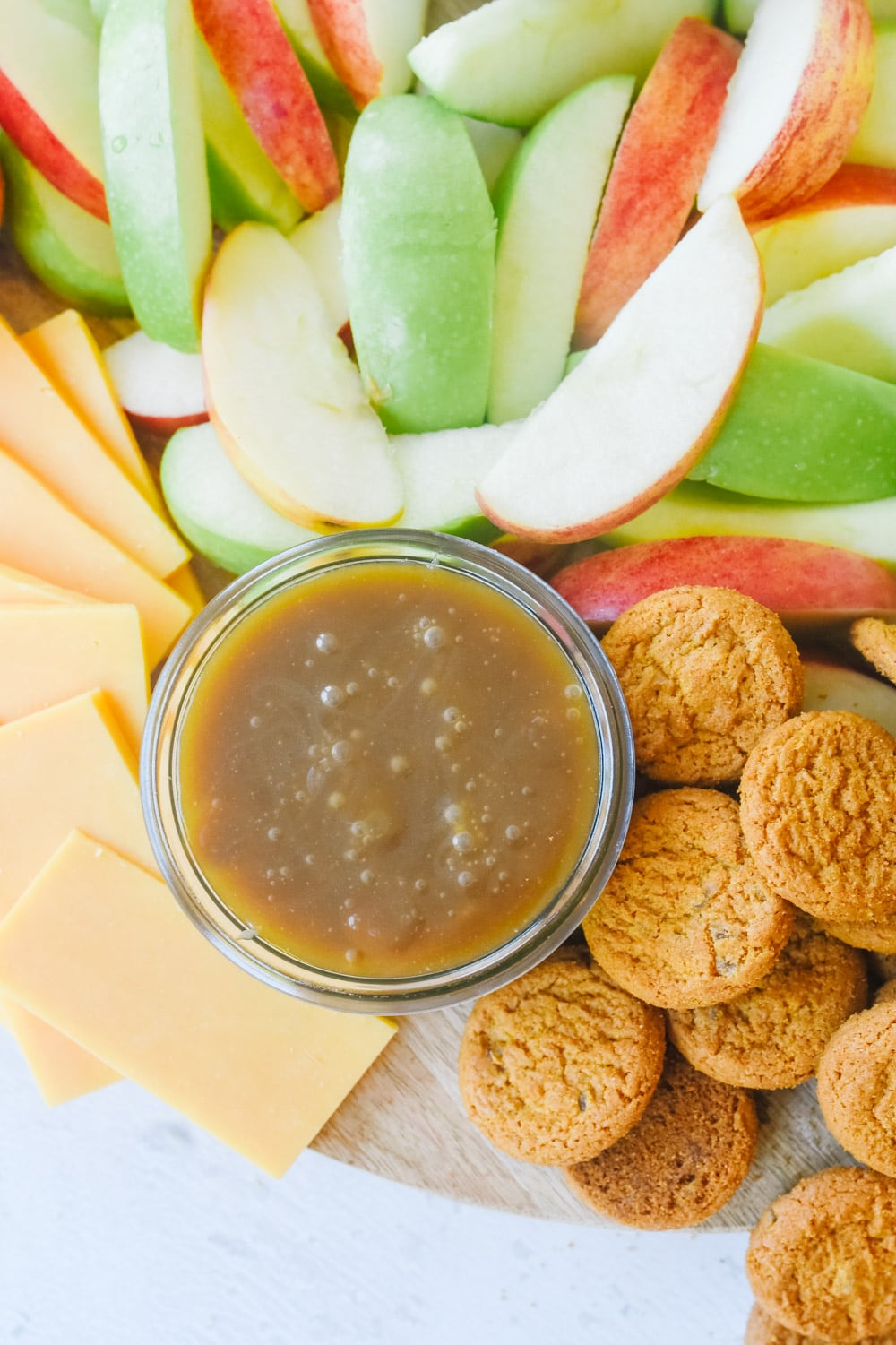 fall snack board with caramel sauce