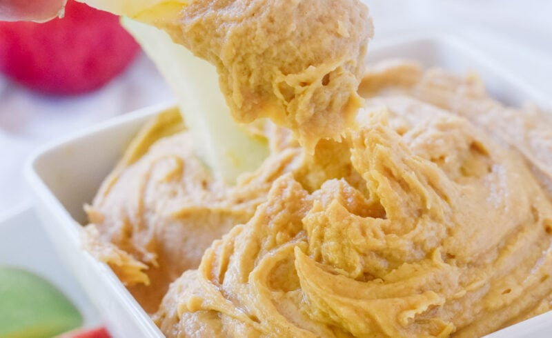apple dipping in peanut butter dip