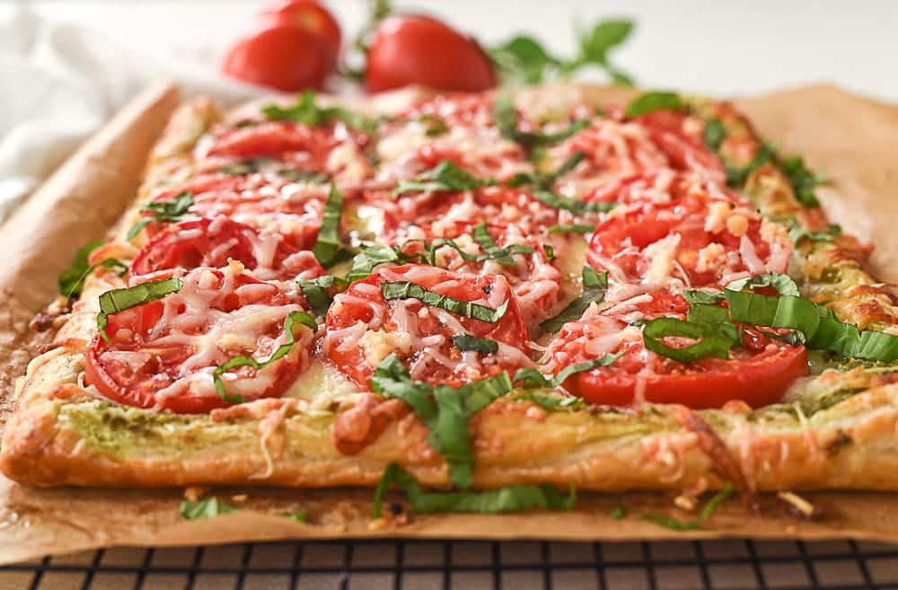 slices of tomato tart on brown paper